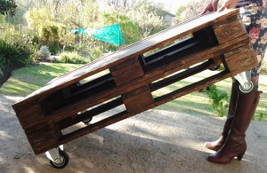 Straight and unwavering like an elegantly crafted used-pallet table lifted at an angle.
