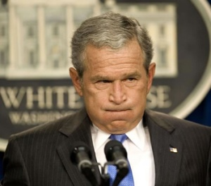 Here's a picture of George W imitating a ship's horn in response to a question about foreign policy.
