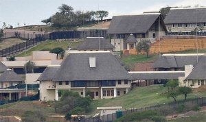 This house is shared by all South Africans. Oops! I left out a word or two. The cost of this house is shared by all South Africans.
