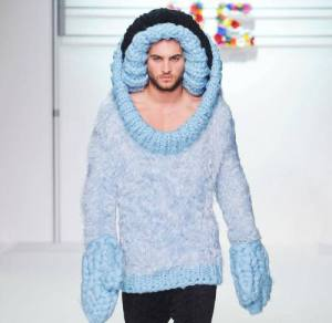 This is either high fashion or a man in oven gloves being eaten by a woollen killer whale.
